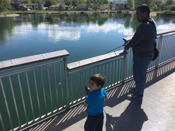 Antonio Cadena and his son, Daniel, fishing at Willow Pond Park in a suburb of Salt Lake City.  It's an urban park filled with birds and - after the stocking - hungry Rainbow trout.
