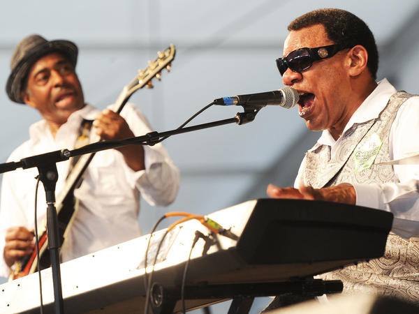 Henry Butler (right), performing at the 2011 New Orleans Jazz & Heritage Festival. Butler died on Monday at age 69.
