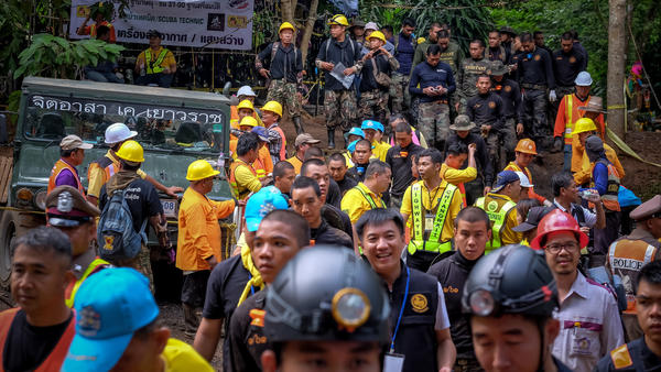 Hundreds of rescuers gather outside the cave Tuesday in Chiang Rai to help load equipment and aid efforts to rescue the 12 boys aged 11 to 16 and their 25-year-old coach.