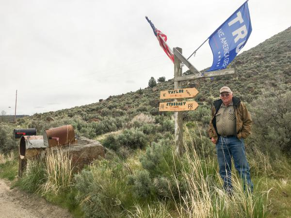 Rancher Buck Taylor proudly flies his American and Trump flags by his driveway mailboxes and signpost in Diamond Valley, Ore. He and other ranchers are facing new tariffs on beef exports that could cost him – but he doesn't blame President Trump.