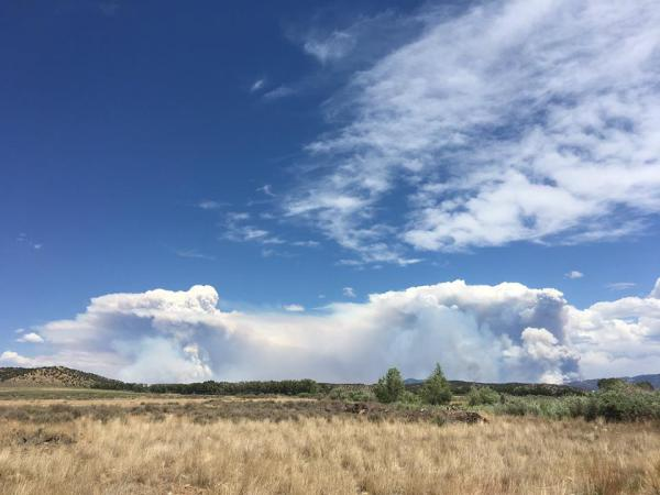This photo taken from Fort Garland shows two distinct columns forming from the Spring Fire burning in southern Colorado.