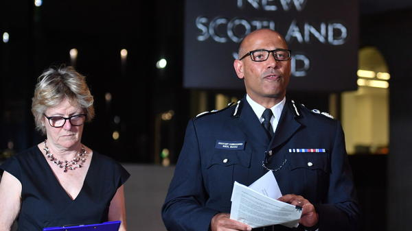 The U.K.'s head of Counter Terrorism Policing Neil Basu (right) and the chief medical officer for England Dame Sally Davies, speak at a news conference at New Scotland Yard in London on Wednesday. British police say a couple who are critically ill were exposed to the Russian nerve agent Novichok.