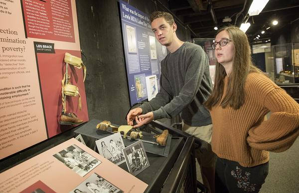 """Gann Academy students Gabe Rosen and Elianna Gerut are two of the curators of the """"Disability History of the United States"""" exhibit at the Charles River Museum of Industry & Innovation in Waltham, Mass. (Robin Lubbock/WBUR)"""