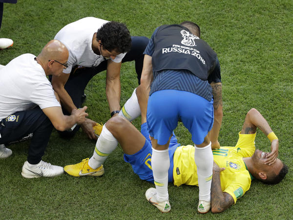 Brazil's Neymar receives medical care during the round of 16 match between Brazil and Mexico at the 2018 soccer World Cup on Monday.