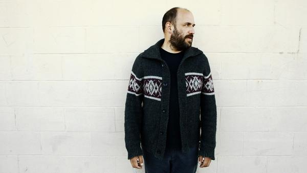 "David Bazan's cover of Now, Now's ""Thread"" appears on volume eight of Kevin Devine's <em>Devinyl Splits</em> series."