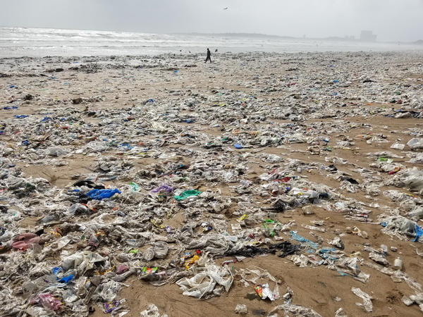 Mumbai's Juhu beach is strewn with trash at low tide during monsoon season. Floodwaters flush garbage out of the city and into the Arabian Sea. As tides ebb, beaches are blanketed in trash, much of it plastic.