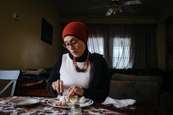 March 20, 2018, Brooklyn, NY - Dr. Debbie Almonteser has a quick breakfast before heading out for a day of meetings and errands. Dr. Almonteser is a influencer in the Yemeni-American community and played a major role in organizing Yemeni bodega owners to boycott after the announcement of President Trump's travel ban.