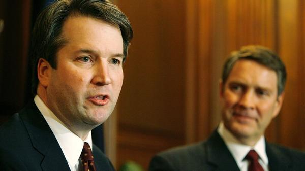 Brett Kavanaugh (left) speaks in 2006, when he was a nominee for the D.C. Circuit Court of Appeals. With him is then-Senate Majority Leader Bill Frist of Tennessee.