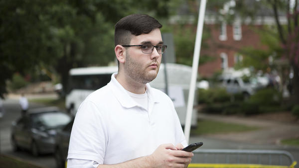 James Alex Fields Jr. stands on the sidewalk ahead of a rally in Charlottesville, Va., on Aug. 12, 2017. He is accused of ramming his car into a crowd of counterprotesters later that day, killing 32-year-old Heather Heyer.