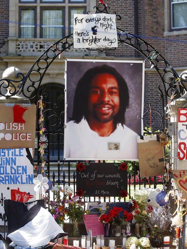 A photo of Philando Castile is attached to the gate of the governor's residence in St. Paul, Minn., part of a memorial to the Minnesota man, who was shot and killed by a police officer in July 2016.