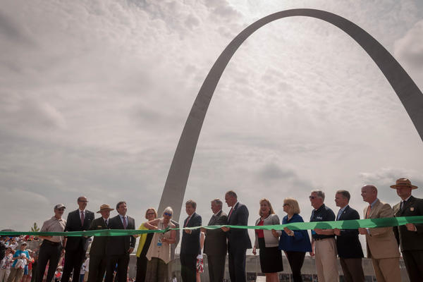 Officials and National Parks Service staff cut the ribbon to the new Gateway Arch visitor center and museum Tuesday.