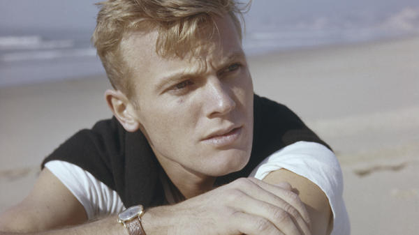 Boy in the Sand: Tab Hunter, who died on July 8th, hits the beach, circa 1955.