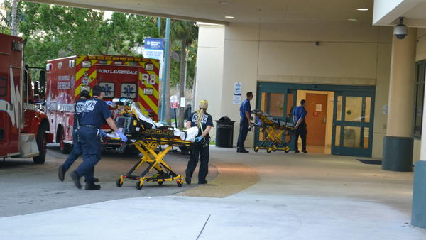 First responders transfer patients from ambulances to Broward Health Medical Center in Ft. Lauderdale on the afternoon of Feb. 14. The hospital was on lockdown after receiving victims of the shooting at Marjory Stoneman Douglas High School.