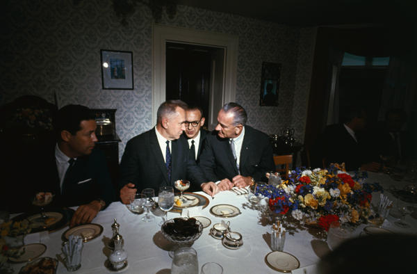 President Lyndon Johnson and Soviet Premier Aleksei Kosygin confer during a luncheon on the campus of Glassboro State College in New Jersey in 1967. Between them is an interpreter.