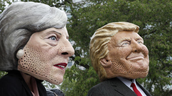 People dressed as U.K. Prime Minister Theresa May (left) and Donald Trump who will be visiting the United Kingdom on July 12.
