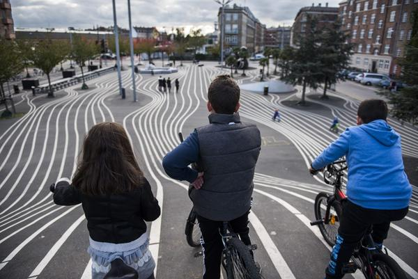 Children get ready to race down a steep hill painted with lines at a recreational area in Copenhagen's Norrebro neighborhood. (Odd Andersen/AFP/Getty Images)