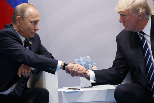 FILE - In this Friday, July 7, 2017 file photo President Donald Trump shakes hands with Russian President Vladimir Putin at the G20 Summit in Hamburg. (AP Photo/Evan Vucci, File)