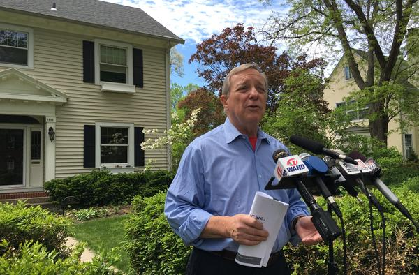Illinois U.S. Senator Dick Durbin speaks with reporters outside his Springfield home in this 2017 file photo.