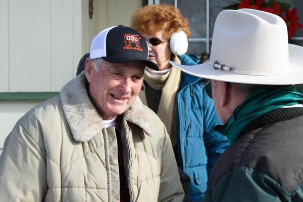 <p>Dwight Hammond Jr., with his wife and supporters, outside his home in Burns, Oregon on Jan. 2, 2016.</p>