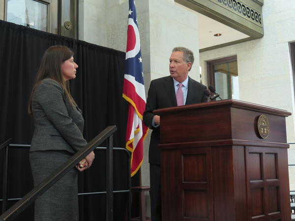 Gov. John Kasich and Tracy Plouck shared the stage at an event for the National Alliance for the Mentally Ill of Ohio in 2017.