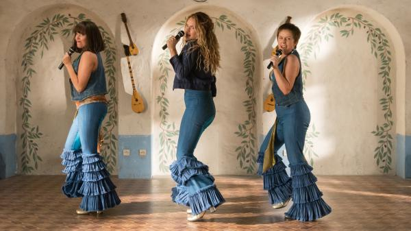 Electric Waterloo: (L to R) Young Tanya (Jessica Keenan Wynn), Young Donna (Lily James) and Young Rosie (Alexa Davies) feel the beat from the tambourine, oh yeah, in <em>Mamma Mia! Here We Go Again</em>.