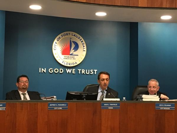 City Clerk Jeffrey Modarelli, Mayor Trantalis, and City Manager Lee Feldman, speaking at Tuesday's City Commission Meeting