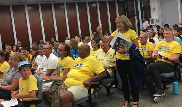 Swimmers and their families celebrate after commissioners approve a maximum of $27 million dollars in renovations to the Ft. Lauderdale Aquatic Center.