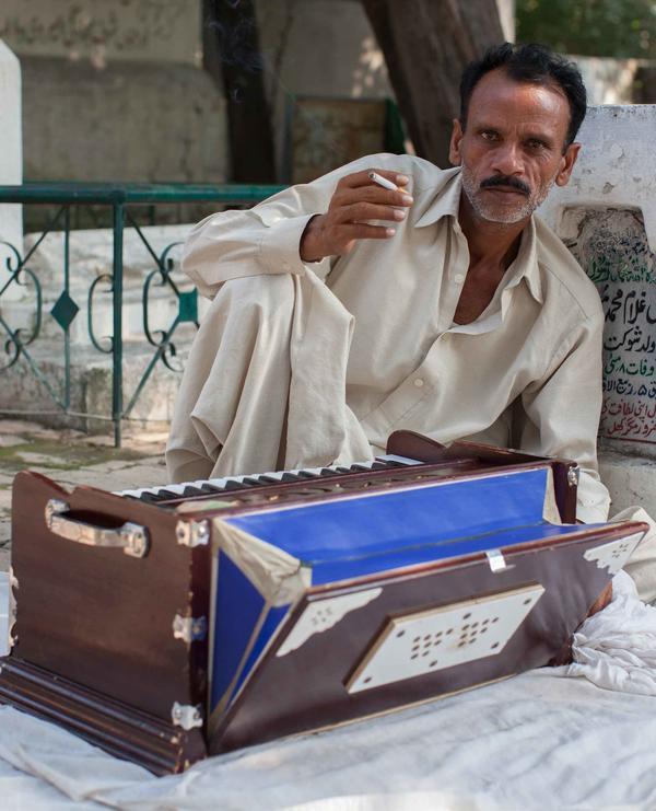 Harmonium player in mosque.