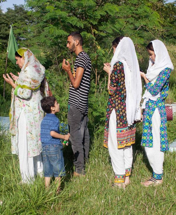 Relatives praying to local holy man.
