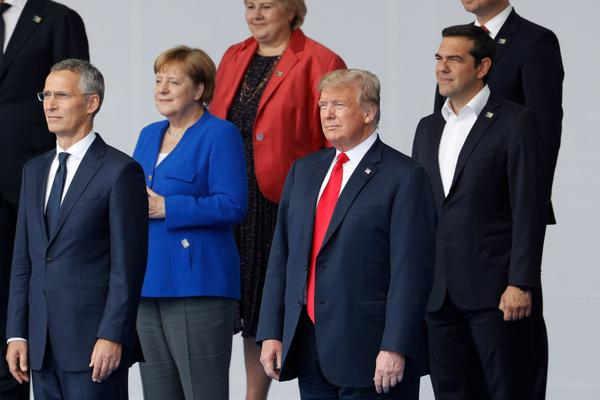NATO Secretary General Jens Stoltenberg, German Chancellor Angela Merkel, President Trump and Greek Prime Minister Alexis Tsipras pose for a family photo ahead of the opening ceremony of the NATO summit at the NATO headquarters in Brussels, on July 11, 2018. (Geoffroy Van Der Hasselt/AFP/Getty Images)