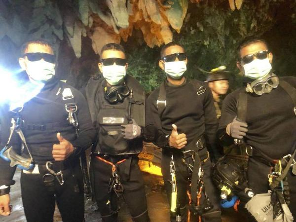 The Royal Thai Navy released this photograph of the Thai Navy SEALs who played a leading role in the rescue, shortly after they emerged safely from the cave.