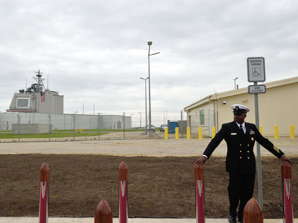 A U.S. Navy senior chief petty officer stands watch ahead of a ceremony inaugurating the U.S. anti-missile station Aegis Ashore Romania at Deveselu, Romania, in 2016. The station is part of NATO's anti-missile shield for Europe.