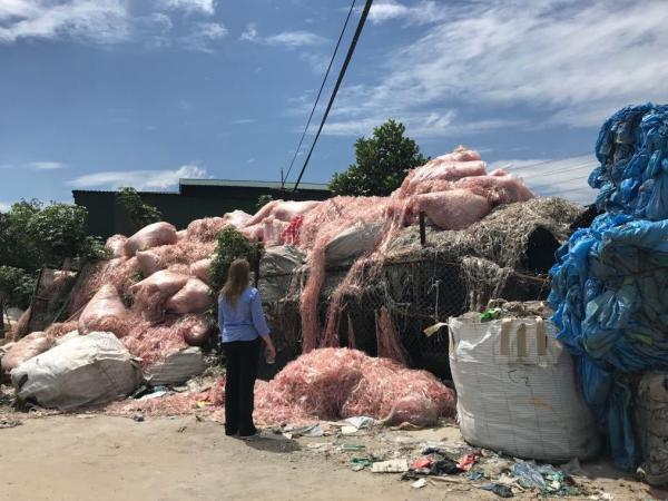 Waste engineer Jenna Jambeck of the University of Georgia surveys plastic waste in a southeast Asian village, where it will be recycled to make raw material for more plastic products. Jambeck advises Asian governments on how to keep plastic trash out of waterways.