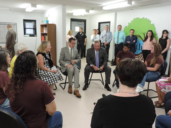 First Lady Cathy Malloy, Governor Dannel Malloy, and Commissioner Scott Semple speaking with inmates at York Correctional about the W.O.R.T.H unit.