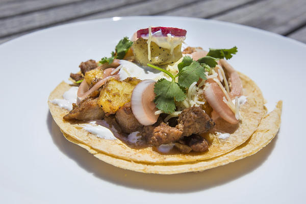 Tacos al pastor rápido with pickled onions. (Jesse Costa/WBUR)