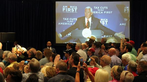 The crowd turns their cellphone cameras to the stage as Vice President Mike Pence appears on stage in Kansas City, Missouri.