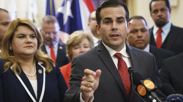 Puerto Rico Gov. Ricardo Rosselló, right, speaks during a ceremony on Capitol Hill on June 27, 2018. On Thursday, Rosselló demanded the resignation of any member of PREPA's board who refused to cut the new CEO's $750,000 salary.