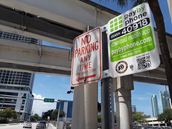 PayByPhone signs can be found around Miami. This one is in front of the WLRN studios.