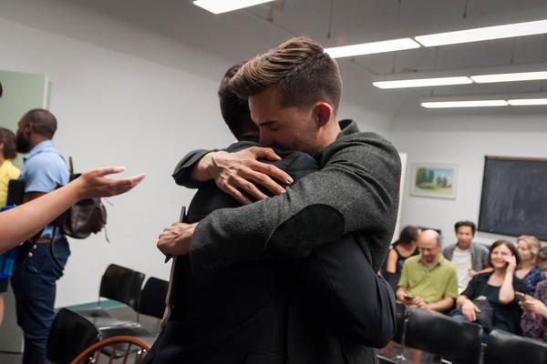 Jack Krewson hugs Gavin Schiffres after the two won sponsorship to open a charter school in St. Louis' Dutchtown neighborhood Wednesday.