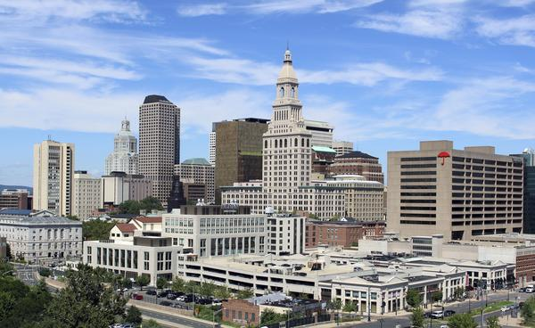 The Travelers Companies tower, center, anchors the skyline of downtown Hartford, Conn., in 2017.
