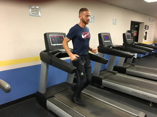 Aaron Yoder practices for the international backward-running championships at Bethany College in Lindsborg, Kansas.