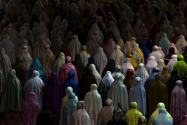 Muslim women praying together in the Istiqlal mosque in Jakarta, Indonesia.