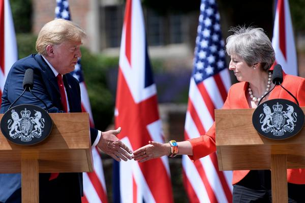 President Trump and Britain's Prime Minister Theresa May shake hands during a joint press conference following their meeting at Chequers, the prime minister's country residence, near Ellesborough, northwest of London on July 13, 2018. (Brendan Smialowski/AFP/Getty Images)