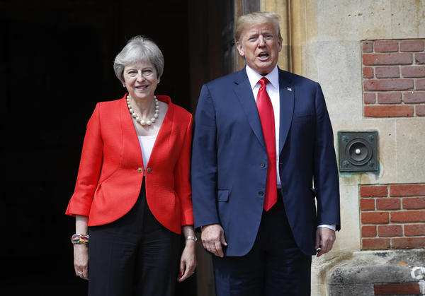 U.S. President Donald Trump, right, stands with British Prime Minister Theresa May, left, at Chequers, in Buckinghamshire, England, Friday, July 13, 2018.