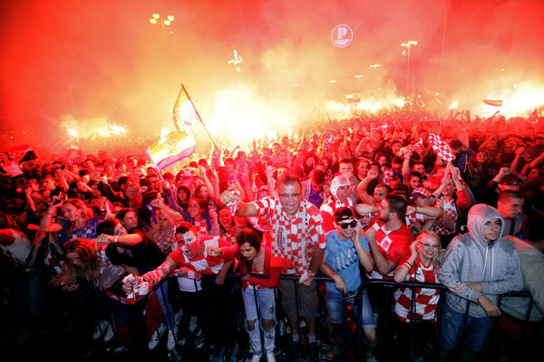 Croatian fans cheer while watching the semifinal match between Croatia and England at the 2018 soccer World Cup, in Zagreb, Croatia, Wednesday, July 11, 2018.