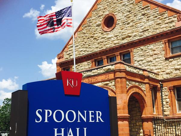 A flag overlaid with images intended to depict divisions in America was flown outside of KU's Spooner Hall. A number of Republican politicians called for its removal before it was relocated to the campus art museum.
