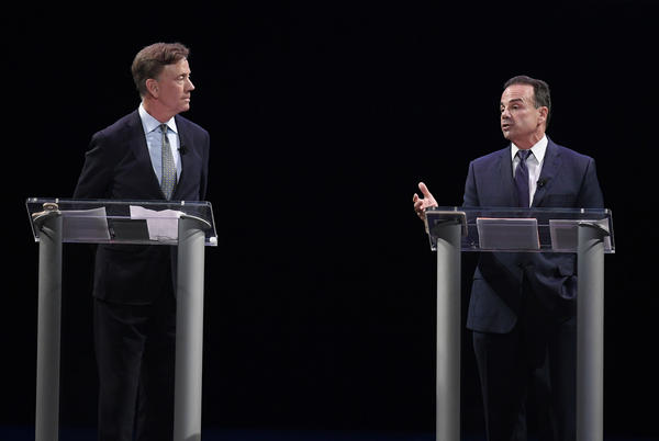Democratic candidates for governor Ned Lamont, left, and Bridgeport Mayor Joe Ganim debate in New Haven, Conn., Thursday. Lamont is the party's endorsed candidate, while Ganim petitioned his way onto the Aug. 14 ballot.