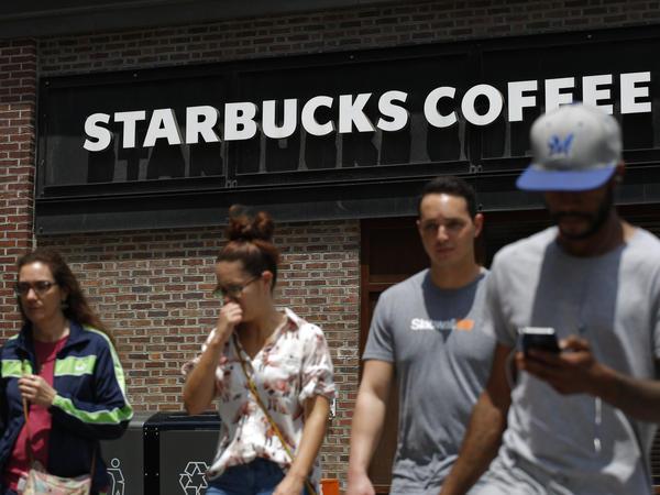 Pedestrians walk outside the closed Spruce St. Starbucks store on May 29, 2018 in Philadelphia, Pennsylvania.