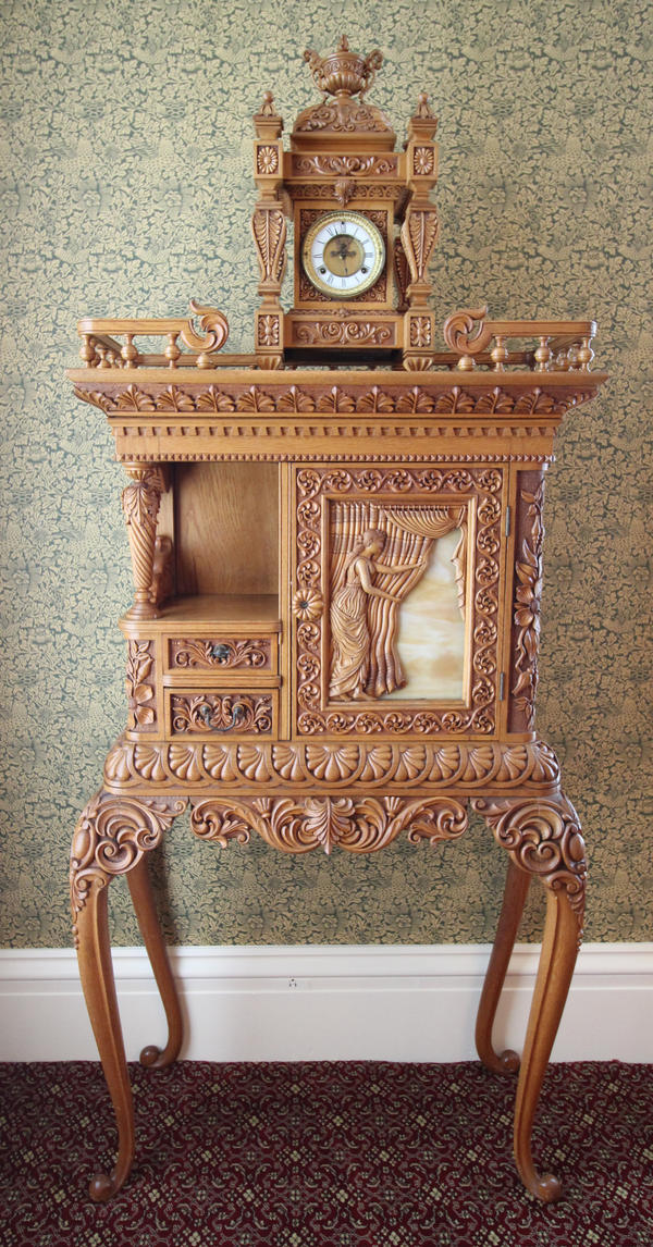 A handcarved piece of furniture by William Bartels. It's part of two room's worth of furniture used by Gov. Altgeld in the Illinois Building at the World's Columbian Exposition in 1893.