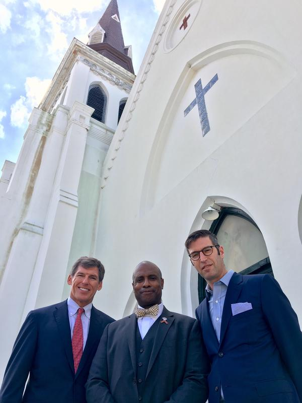 John Darby, president of the Beach Company (left); the Rev. Eric S.C. Manning, pastor of Emanuel AME Church (center); and architect Michael Arad stand in front of the church in Charleston, S.C. Darby is helping lead efforts to fundraise for the memorial, which Arad is designing.